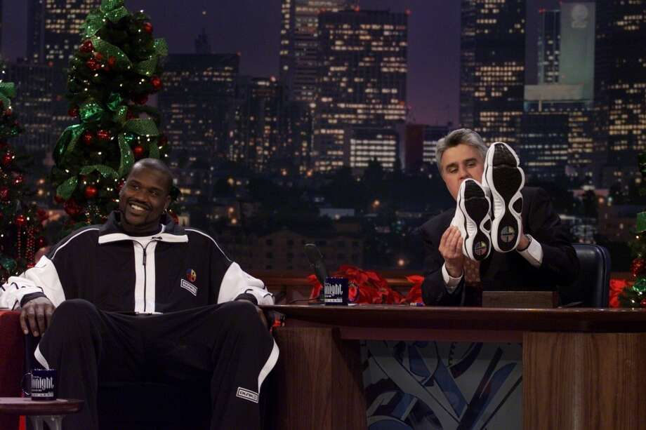 "At 7-foot-1, Shaq is one of the biggest guys to ever play in the NBA. His shoe size is 23. PHOTO: Host Jay Leno compares his shoes with Shaquille O'Neal's on ""The Tonight Show,"" on Dec. 22, 1999. Photo: NBC, NBCU Photo Bank Via Getty Images"