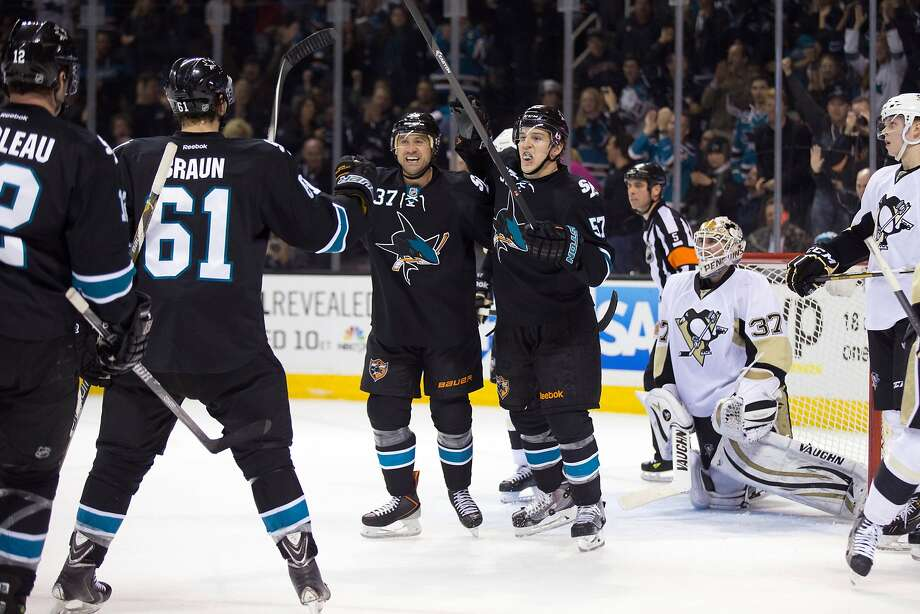 Adam Burish (37) celebrates with Tommy Wingels (57), Justin Braun (61) and Patrick Marleau (12) after scoring in the second period. Photo: Kelley L Cox, Reuters