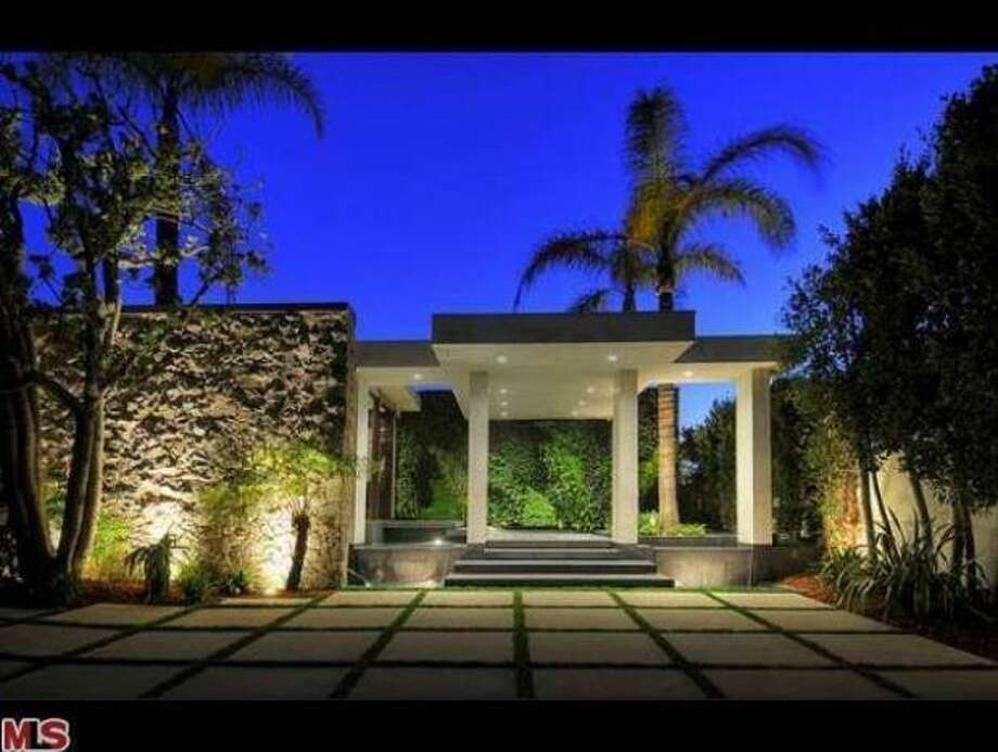 Post-flip, an imposing Hollywood-ready exterior. Photos: MLS/Yahoo Homes