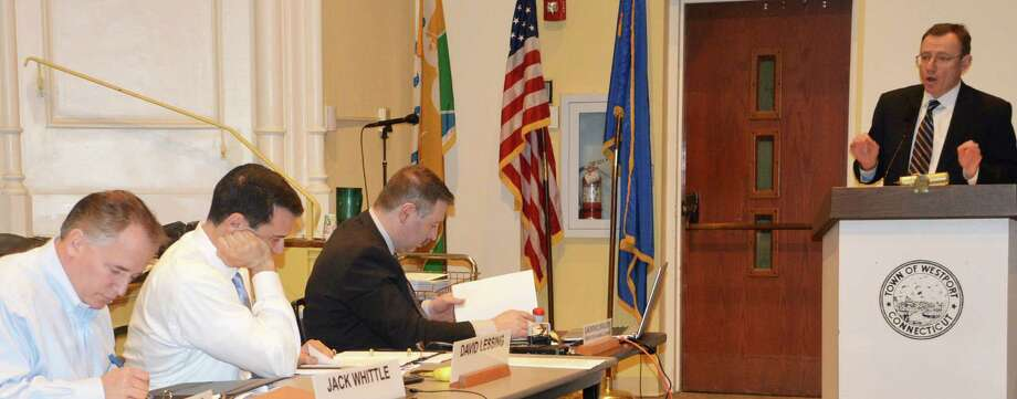 Thomas Cody, at podium, the lawyer for Bedford Square Associates, told the Planning and Zoning Commission it would likely face a lawsuit if it adopts a zoning amendment that would limit the size of retail outlets. Photo: Jarret Liotta / Westport News