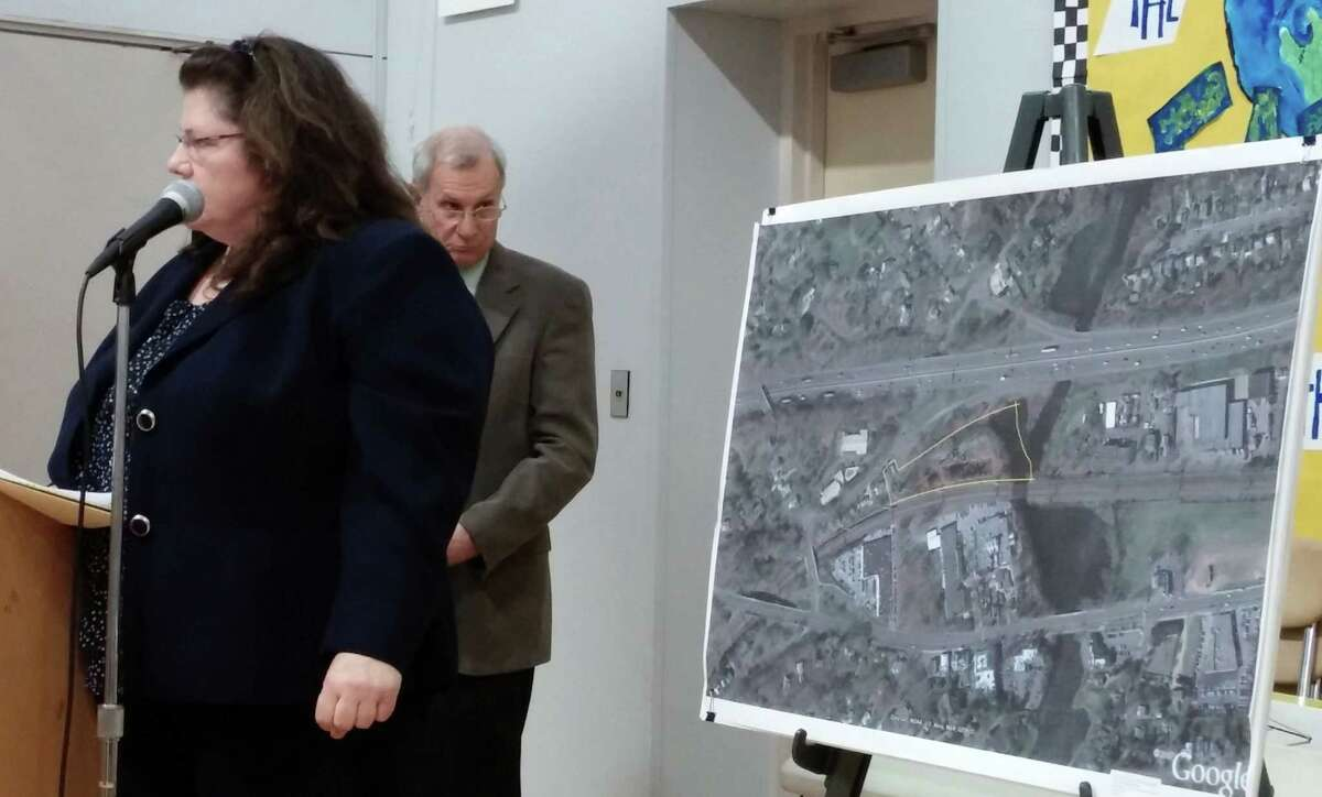 Kathryn Braun, the lawyer for opponents of a proposed 96-unit apartment building on lower Bronson Road, and Mark Branse, the lawyer for the developer, clashed several times during Thursday night's Inland Wetlands Commission hearing on the proposal.