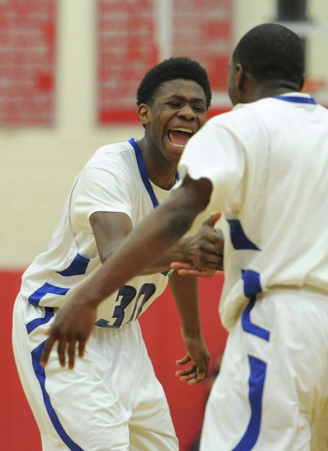 Bunnell's Romklyns Joseph, left, celebrates with teammate Ryan Pittman in the SWC boys basketball championship game between No. 2 Bunnell and No. 5 Kolbe Cathedral at Pomperaug High School in Southbury, Conn. Thursday, March 6, 2014. Photo: Tyler Sizemore / The News-Times