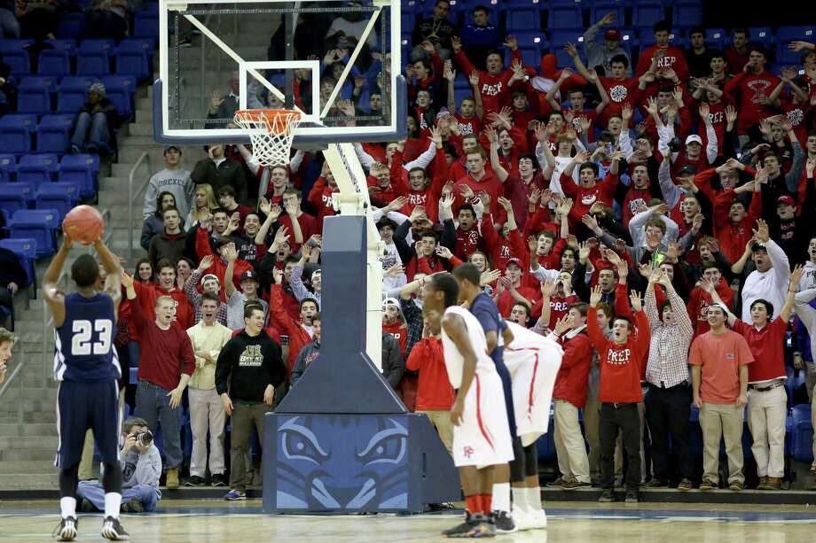 Fairfield Prep's students distract a foul point attempt shot from a Hillhouse High School player during Wednesday evening SCC Championships at Quinnipiac University's TD Bank Sports Center. Prep would win 56-52. Photo: Mike Ross / Mike Ross Connecticut Post freelance -www.mikerossphoto.com