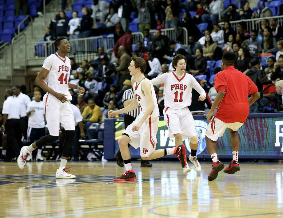 Fairfield Prep's players celebrate midcourt after their SCC Championships win over Hillhouse High School on Wednesday evening. Prep would win 56-52. Photo: Mike Ross / Mike Ross Connecticut Post freelance -www.mikerossphoto.com