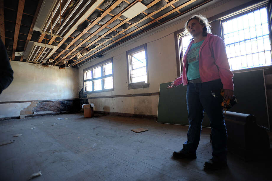 Beth Schrek looks around the Oil City Brass Works building in downtown Beaumont on Friday. Schrek and her partners hope to have the building refurbished into a children's museum by the end of 2013. Photo taken Friday, January 27, 2012 Guiseppe Barranco/The Enterprise Photo: Guiseppe Barranco, STAFF PHOTOGRAPHER / The Beaumont Enterprise