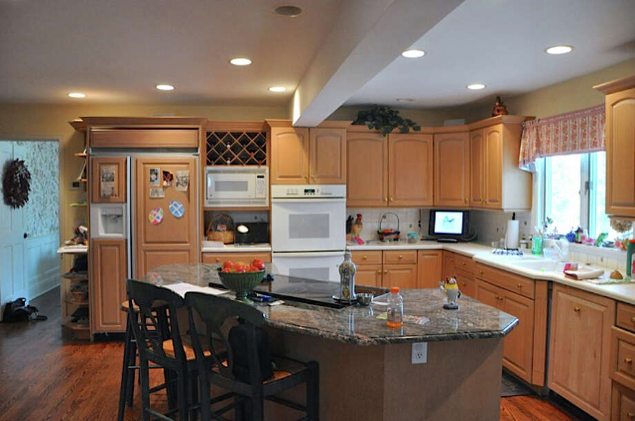 Darienite Stephanie O'Malley hired True North Cabinets, of New Canaan, to redesign her kitchen last year. The designer flipped the dining and cooking areas to make it more functional. Seen here is the kitchen before the design and construction. Photo: Contributed Photo, Contributed / New Canaan News