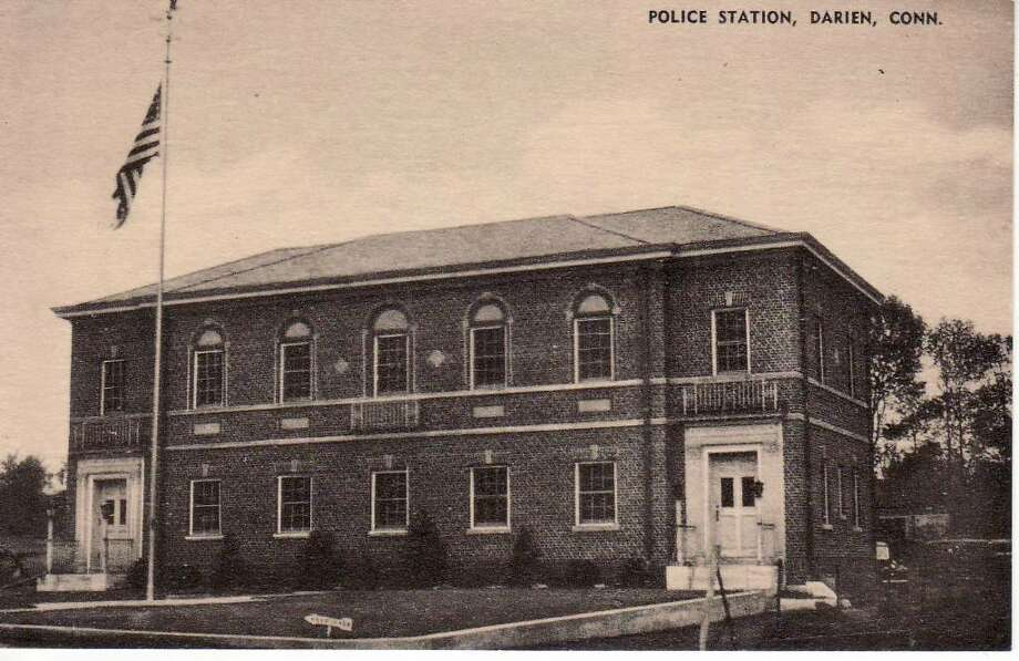 This postcard shows the Police Headquarters as it has stood since it was first built in 1932. The building, located on Hecker Avenue, cost $30,500 to construct. Photo: Contributed Photo / Darien News