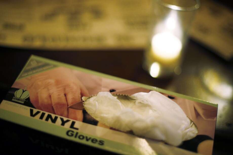 A box of vinyl gloves sits ready for use behind the bar at 15 Romolo in San Francisco, Calif., on Wednesday, March 5, 2014. A new glove law was passed in January that requires any restaurant worker or bartender who prepares ready-to-eat food or drinks to wear gloves. The law has received so much blow back that the people who passed the legislation are now trying to repeal it. But until that happens, starting in June, the food industry has to adhere to the new rules. Photo: Carlos Avila Gonzalez, The Chronicle