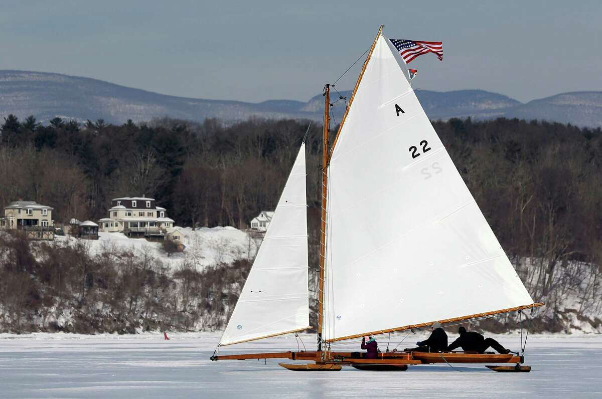 An ice boat sails along the Hudson River on Saturday, March 1, 2014, in Barrytown, N.Y. This year's frigid winter has created excellent conditions for ice sailing on the Hudson River in New York. (AP Photo/Mike Groll) ORG XMIT: NYMG201