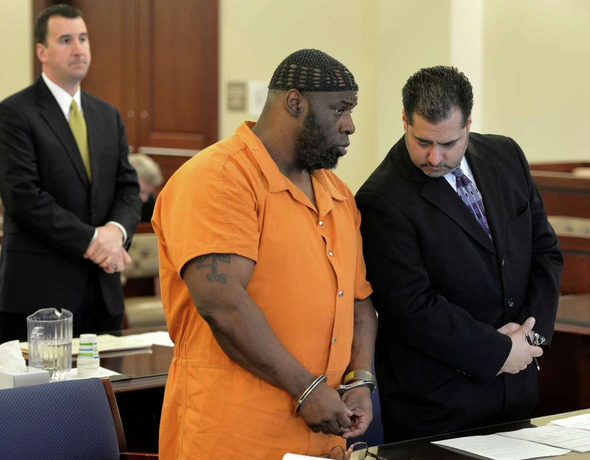Robert Williams, 41, appears in Albany County Court, left with his defense attorney Michael Jurena for sentencing Friday morning March 7, 2014 in Albany, N.Y. Williams was convicted in January of murdering his wife in her West Hills home last spring. (Skip Dickstein / Times Union)