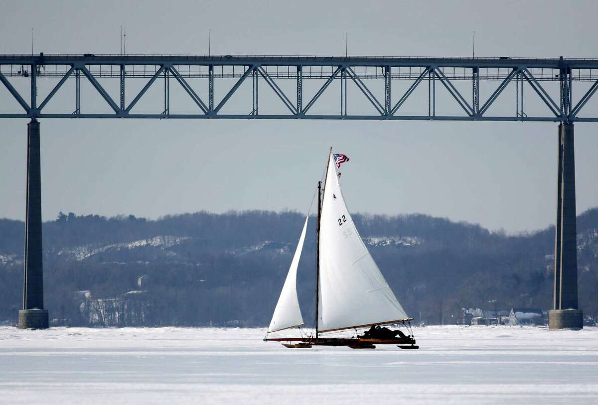 An ice boat sails along the Hudson River near the Kingston-Rhinecliff Bridge on Saturday, March 1, 2014, in Barrytown, N.Y. More than a dozen boats hit the ice last weekend on a wide stretch of the river about 100 miles north of New York City. (AP Photo/Mike Groll) ORG XMIT: NYMG209