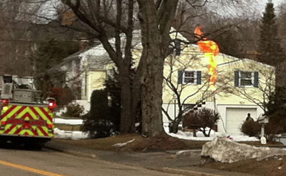 Firefighters burn off gas from a leaking tank at a High Street home. Photo: Genevieve Reilly, Fairfield Citizen