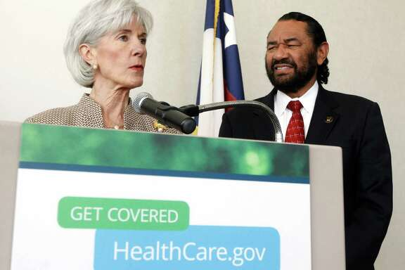 U.S. Health and Human Services Secretary Kathleen Sebelius speaks at the Fountain of Praise Church with U.S. Representative Al Green at her side on Thursday, March 6, 2014, in Houston. The Secretary is in Houston to encourage people to sign up for insurance under the Affordable Care Act.( J. Patric Schneider / For the Chronicle )