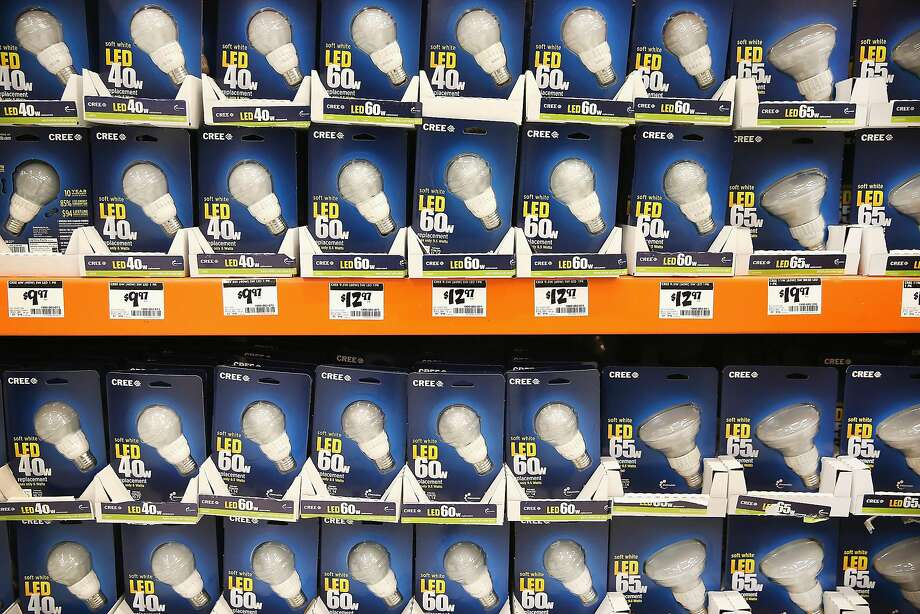 LED light bulbs are offered for sale at a Home Depot store on December 27, 2013 in Chicago, Illinois. On January 1, 2014 manufacturers will stop producing 40 and 60 watt incandescent light bulbs in the United States. The 75 and 100 watt bulbs were discontinued in 2013. These incandescent bulbs are being replaced by the more energy efficient compact florescent and LED light bulbs.  (Photo by Scott Olson/Getty Images) Photo: Scott Olson, Getty Images