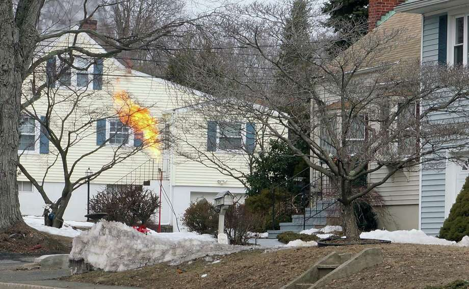 Firefighters used a flare tower to burn off gas in a propane tank with a faulty shut-off valve. The tank was taken from a home under construction on High Street, and brought to the middle of Country Road for burn-off. Photo: Genevieve Reilly / Fairfield Citizen