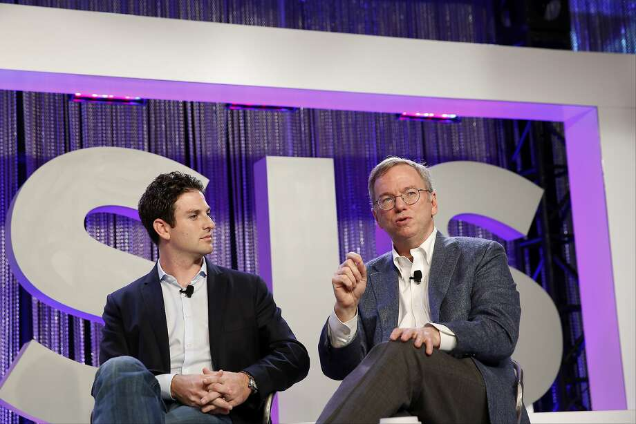 Jared Cohen, director of Google Ideas, and Google Chairman Eric Schmidt take part in a discussion at Oasis: The Montgomery Summit in Santa Monica, where the company's push beyond search was a topic. Photo: Patrick T. Fallon, Bloomberg