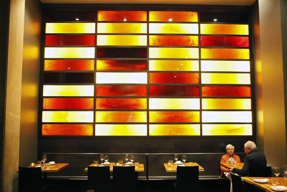 "The ""Honey Walls"" at Coachman are made of panels that contain different varieties of honey. Photo: Michael Short, The Chronicle"