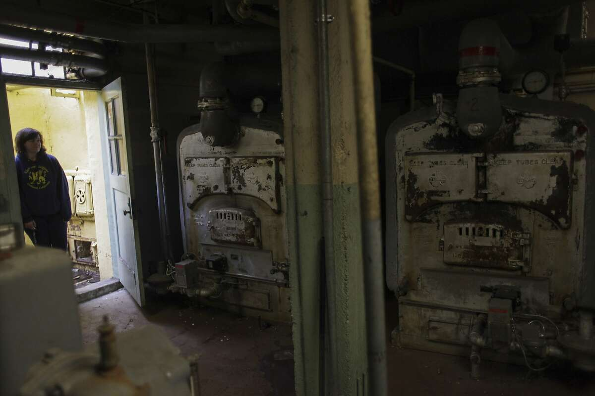 Chelsea Toller, the principle at Glenview elementary a 1920s Art Deco school that might be rebuilt or torn down, looks at the boiler room on March 6th 2014. The equipment in the boiler room has been the same since the school was first build in 1927.