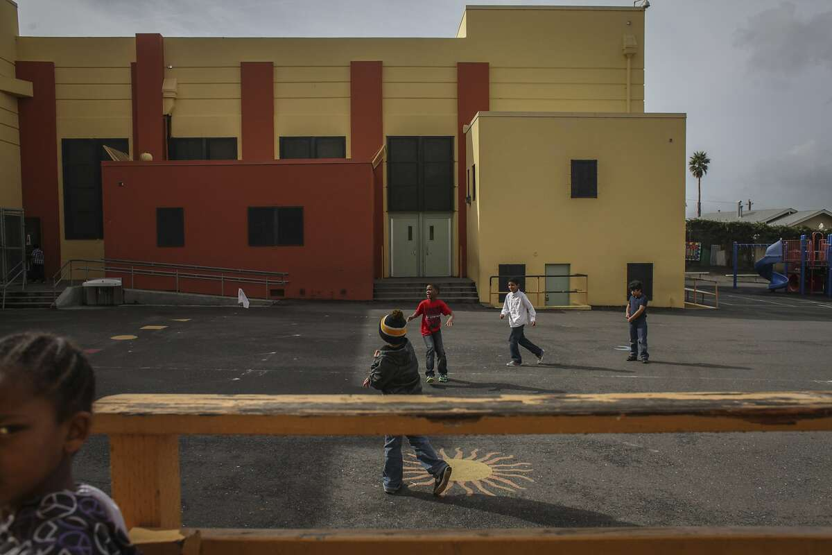 Children play in the school courtyard of Glenview elementary, a 1920s Art Deco school that might be rebuilt or torn down, on March 6th 2014.