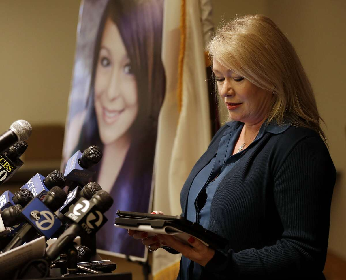 Sheila Pott, mother of Audrie Pott, reads a statement in support of Audrie's Law on Friday, March 7, 2014, in Saratoga, Calif. Audrie's Law is a legislative proposal aimed at deterring the bullying, cyberbullying, and sexual assault that played roles in the suicide of Audrie Pott, a 15-year-old Saratoga High School student. (AP Photo/Marcio Jose Sanchez)