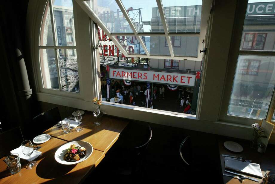 The Penn Cove Mussels dish photographed with the spectacular view of a Seattle landmark at Matt's in the Market on Thursday, August 23, 2007 in Seattle.  Photo by Joshua Trujillo Photo: Joshua Trujillo, Seattlepi.com File Photo / Seattle Post-Intelligencer
