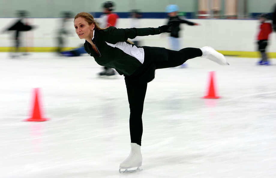 """Ice skating at NorthwoodsSan Antonio is not typically blanketed with enough snow to skate, but the Ice & Golf Center at Northwoods offers a full calendar for """"holiday public skating"""" throughout December. Photo: KIN MAN HUI, SAN ANTONIO EXPRESS-NEWS / San Antonio Express-News"""