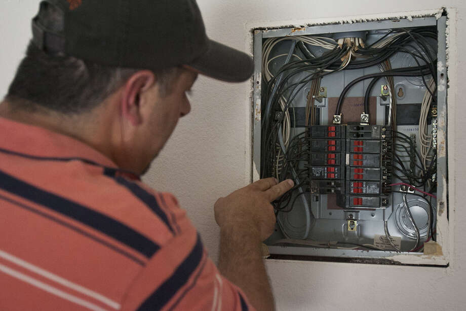 If a breaker trips repeatedly, the problem could signal an overloaded circuit. Leave repairs to a licensed electrician. Photo: Express-News File Photo / sfinneran@express-news