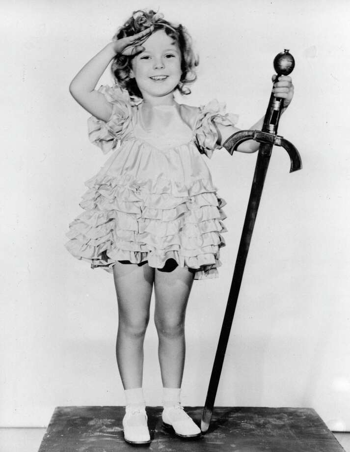 "FILE - In this 1933 file photo, child actress Shirley Temple is seen in her role as ""Little Miss Marker."" Shirley Temple, the curly-haired child star who put smiles on the faces of Depression-era moviegoers, has died. She was 85. Publicist Cheryl Kagan says Temple, known in private life as Shirley Temple Black, died Monday night, Feb. 10, 2014, surrounded by family at her home near San Francisco. (AP Photo/File) ORG XMIT: TOK305 Photo: Uncredited / AP"