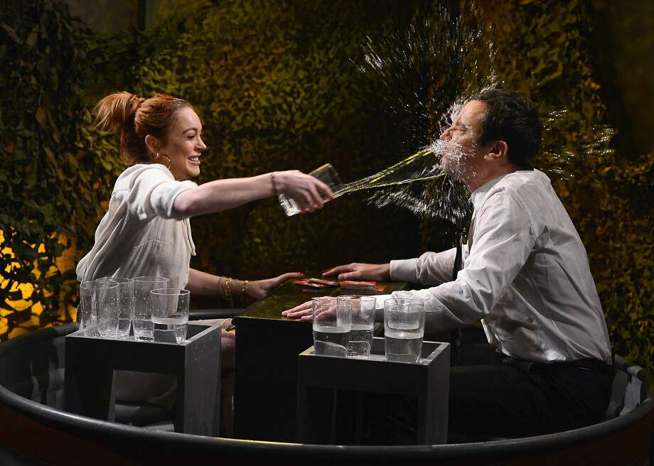 "Care for a sip? Lindsay Lohan and Jimmy Fallon share drinks during a taping of ""The Tonight Show"" at Rockefeller Center in New York City. Photo: Theo Wargo/NBC, Getty Images For ""The Tonight Sh"