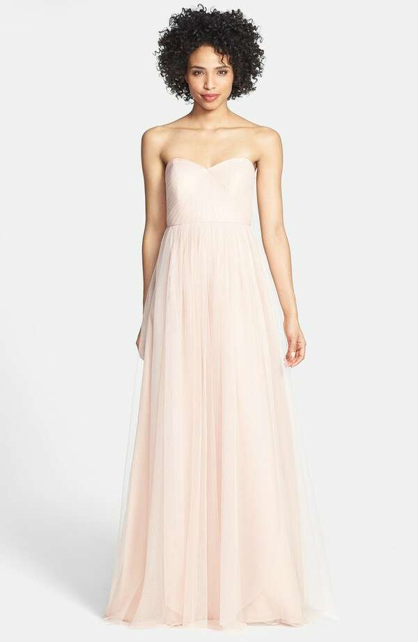 This Jenny Yoo dress has convertible tulle panels allowing you to style it several ways.  'Annabelle' Convertible Tulle Column Dress, $260, Nordstrom.com. Photo: Nordstrom
