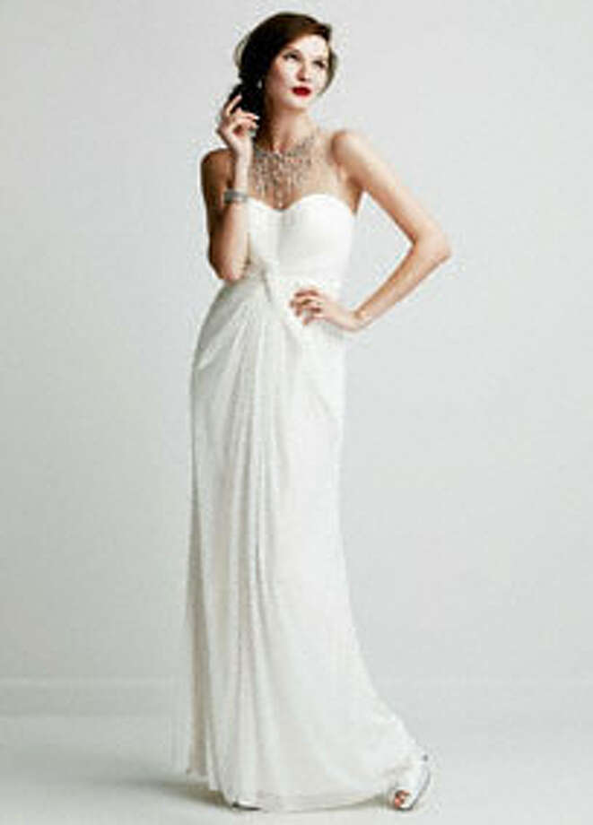 This gorgeous dress is sure to turn heads. Long Mesh Dress with Illusion Beaded Neckline, $199,   DavidsBridal.com. Photo: David's Bridal