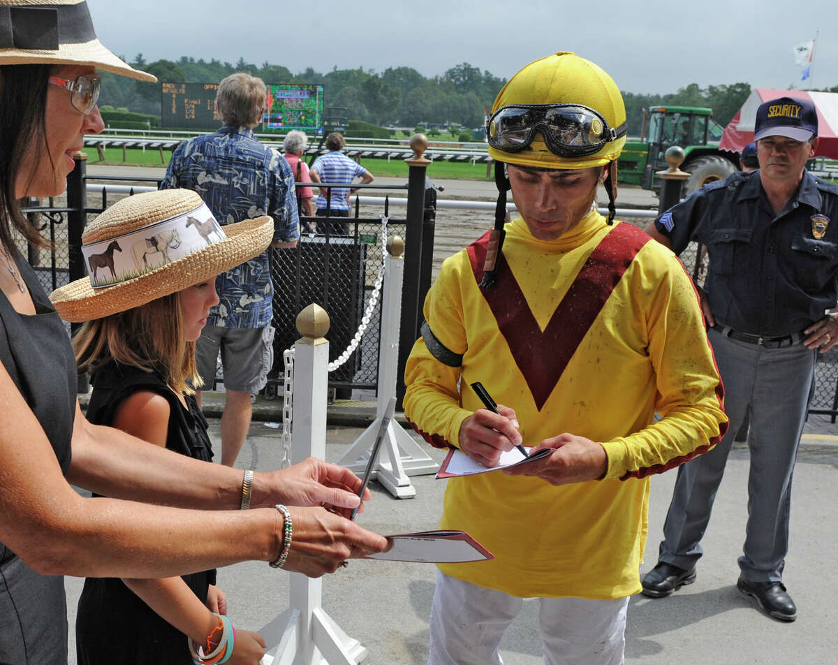 Jockey Garrett Gomez signs autographs at Saratoga Race Course in Saratoga Springs on Aug. 16, 2010. Gomez is among four jockeys, four horses and two trainers have made the cut and are the 10 finalists for the National Museum of Racing's 2014 Hall of Fame ballot. Discuss the ballot on the Talking Horses blog.