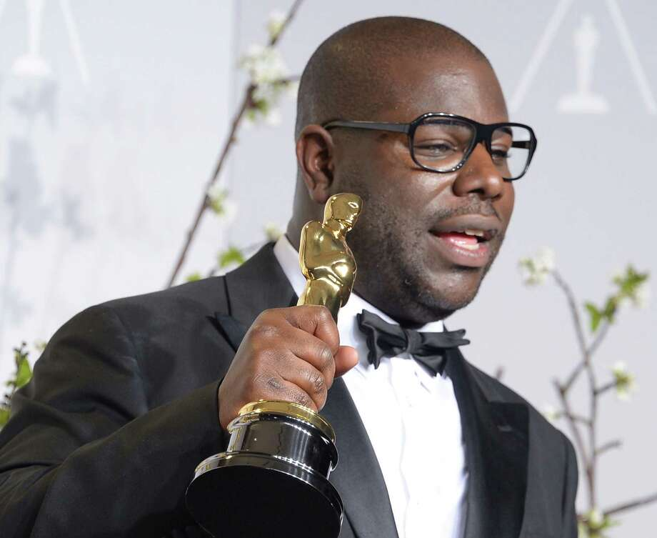 "Director Steve McQueen, winner of Best  Picture for ""Twelve Years a Slave"" poses during the 86th Academy Awards. The movie forced a serious examination of slavery into the national consciousness. Photo: Joe Klamar / AFP/Getty Images / AFP"