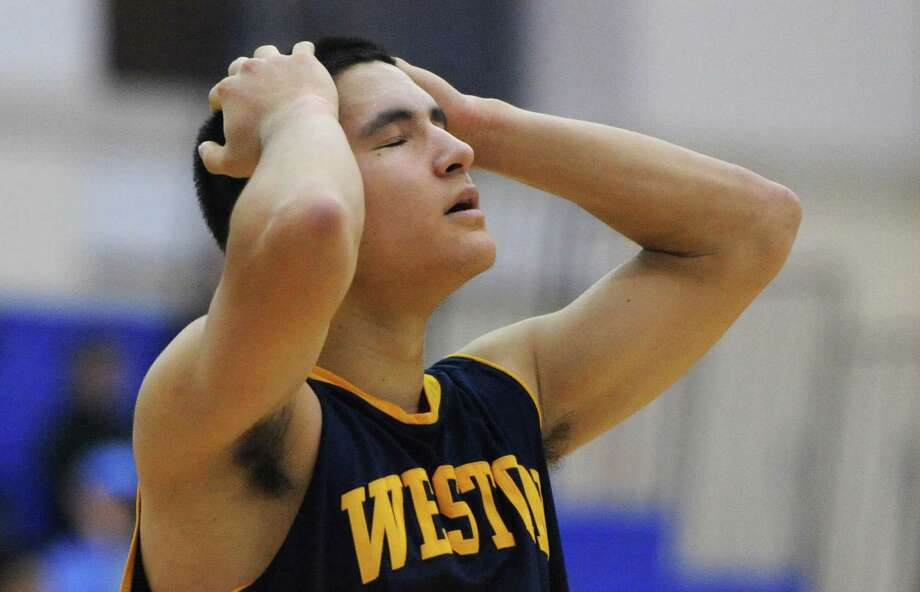Weston's Asher Lee-Tyson reacts after a Bunnell basket in No. 2 Bunnell's 46-45 overtime win over No. 3 Weston in the SWC boys basketball semifinal game at Newtown High School in Newtown, Conn. Tuesday, March 4, 2014. Photo: Tyler Sizemore / The News-Times