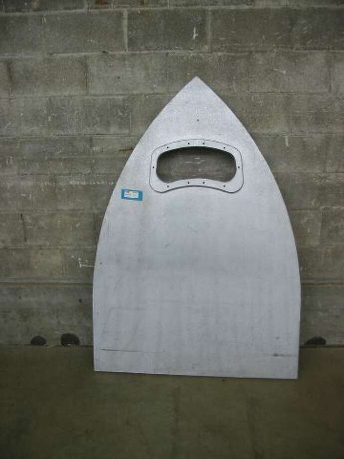 """Space Ship Headboard or Giant Ouiji Board Pointer ... Made from particle board and painted silver."" Price: $25. Photo: Second Use"