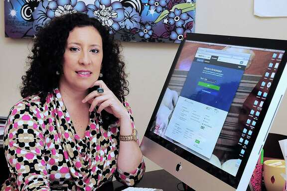 Sandy Castillo, a self-employed consultant, shows the Affordable Care Act website where she was able to get help in acquiring health insurance.