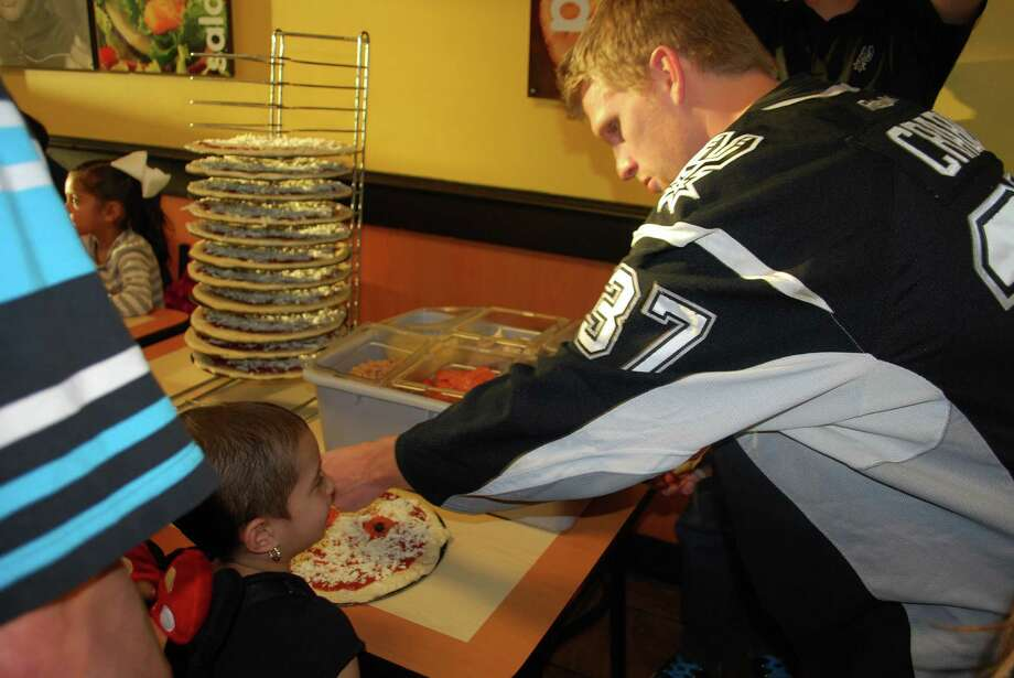Rampage player Joey Crabb joins Alexia Ibarra at the Face-Off Against Kids Cancer pizza party on Wednesday March 5 at CiCi's Pizza at San Pedro and Oblate.  Rampage player Joey Crabb joined the Face-Off Against Kids Cancer pizza party on Wednesday March 5 at CiCi's Pizza at San Pedro and Oblate. Photo: Courtesy