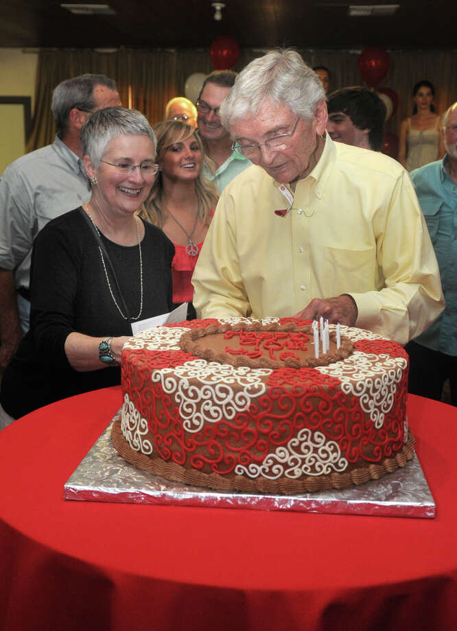 More than 500 fans turned out for Leon Hale's 90th birthday party in Round Top in 2011. His wife, Babette, helps him cut one of the cakes. Photo: Jerry Baker, Freelance