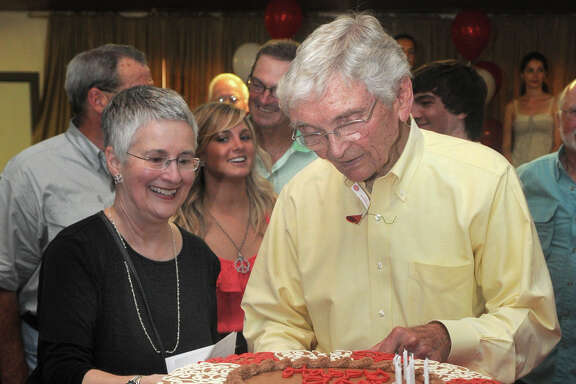 More than 500 fans turned out for Leon Hale's 90th birthday party in Round Top in 2011. His wife, Babette, helps him cut one of the cakes.