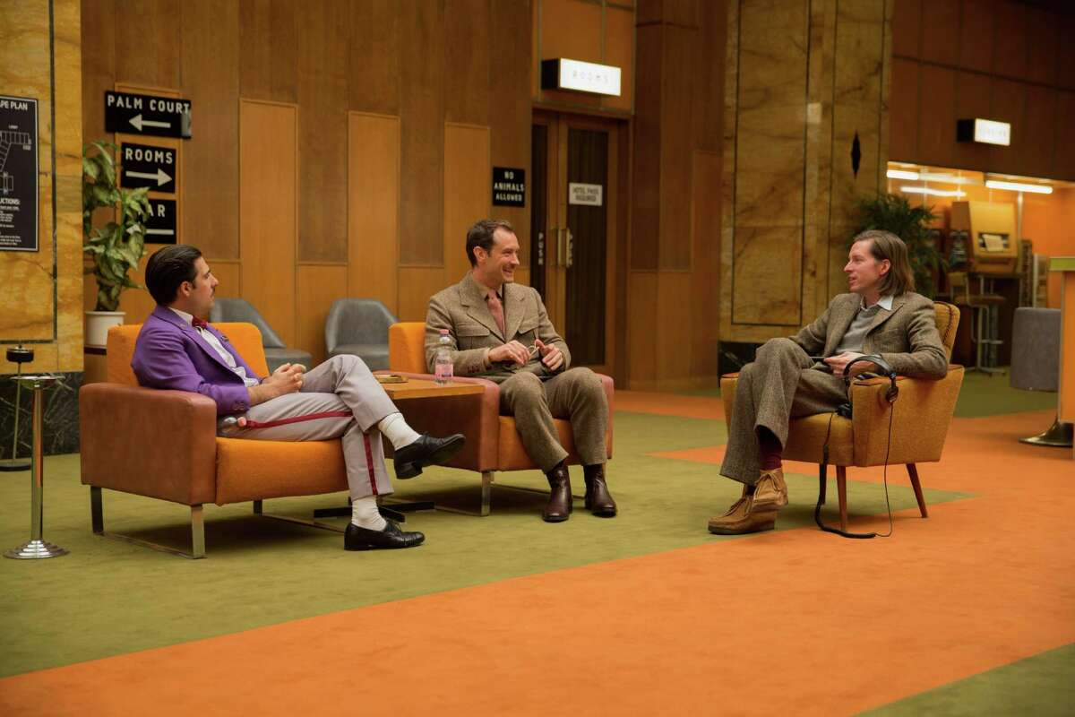 Jason Schwartzman, Jude Law and Wes Anderson on the set of The Grand Budapest Hotel