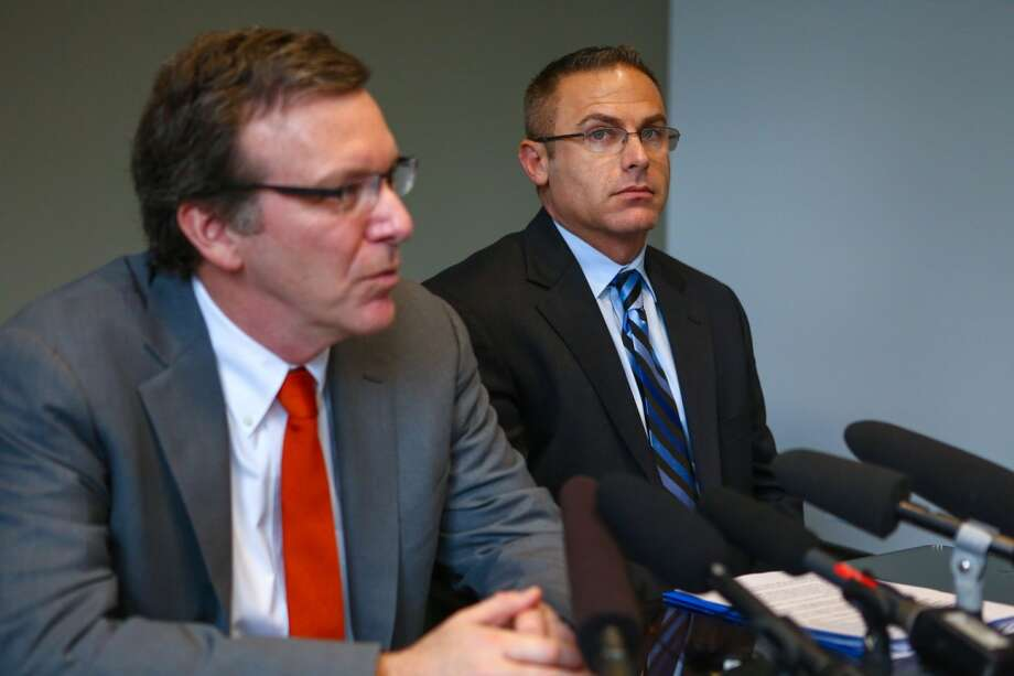 Attorney Richard Friedman, left, and former Eastside Catholic High School Vice Principal Mark Zmuda speak to the news media at Friedman's law offices in downtown Seattle as they formally announce a lawsuit against the school and the Archdiocese of Seattle. Zmuda was fired from his position at the school late last year after it was discovered he entered into a same sex marriage. Students rallied around the vice principal after he was fired. Photographed on Friday, March 7, 2014. Photo: JOSHUA TRUJILLO, SEATTLEPI.COM
