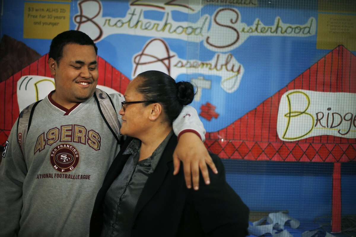 Robert hugs his mom, Maggie Winterstein, in the hallway at Lincoln High School in San Francisco, Calif., on Tuesday, March 4, 2014. Through the Legal Education Advocacy Project, the San Francisco Public Defender's office provides legal help for students navigating educational needs after they've dealt with criminal charges. These lawyers help students receive the support they need to get back in school as well as counseling and proper placement in classes that will benefit them the most.