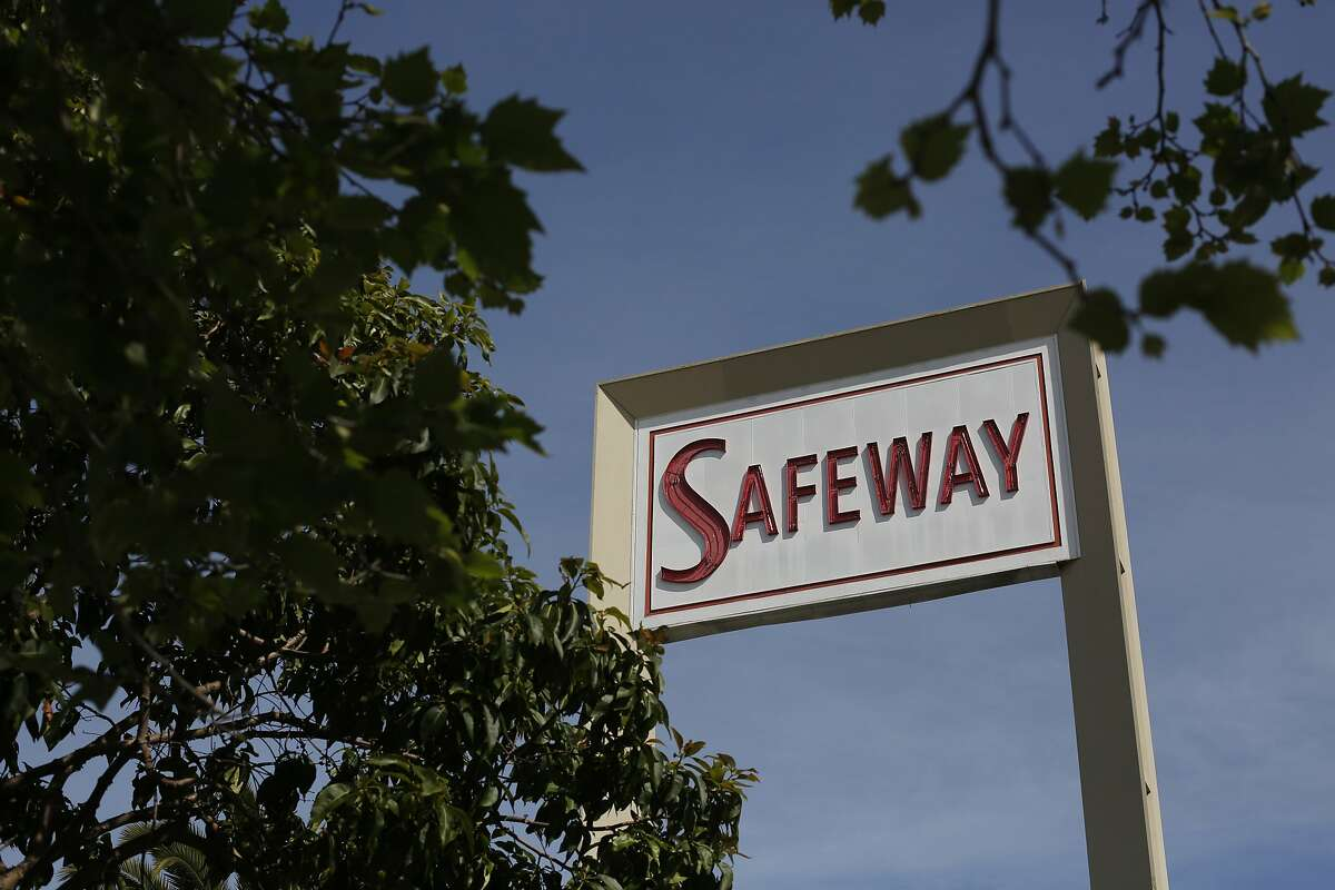 After a New York investment firm called Cerberus bought the grocery chain for $9 billion, A vintage Safeway sign looms over the parking lot at the store on Market and Church Streets on Friday March 7, 2014 in San Francisco.