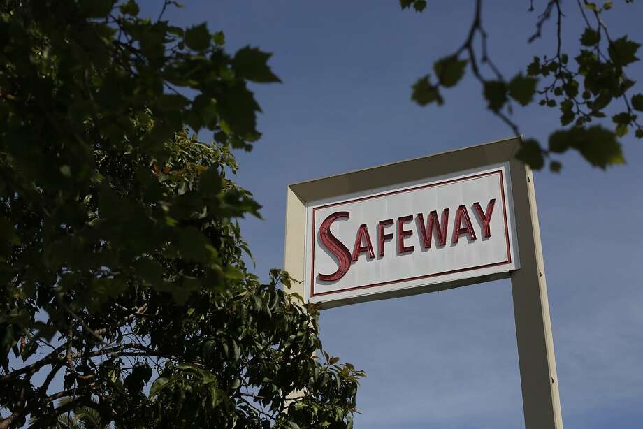 After a New York investment firm called Cerberus bought the grocery chain for $9 billion, A vintage Safeway sign looms over the parking lot at the store on Market and Church Streets on Friday March 7, 2014 in San Francisco. Photo: Mike Kepka, The Chronicle
