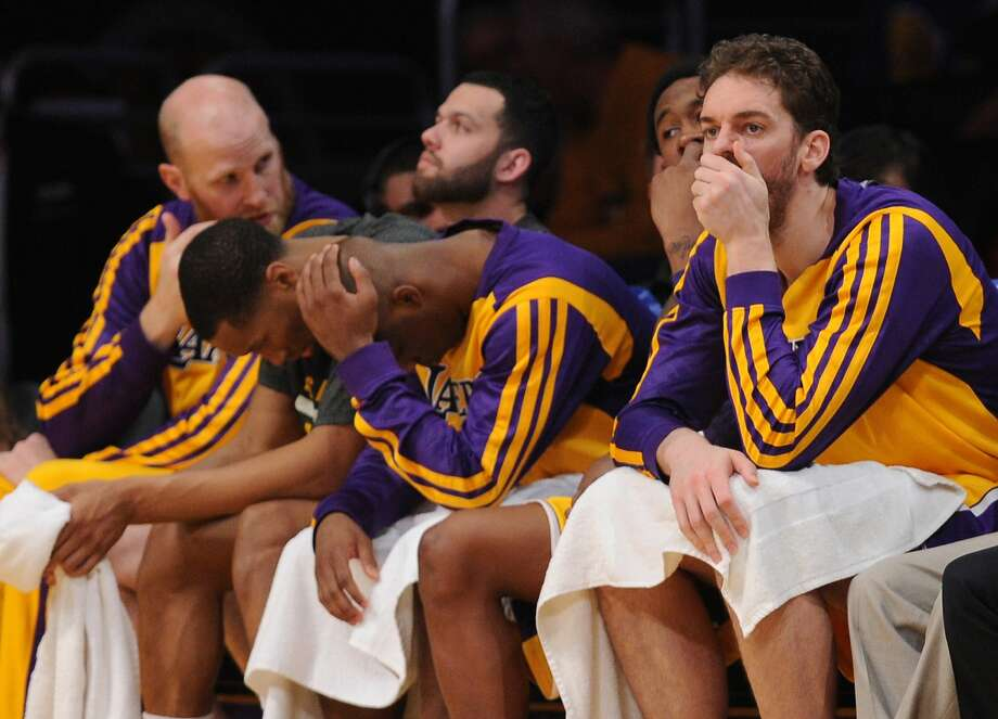 Los Angeles Lakers Pau Gasol (R) sits on the bench with his teammates in the fourth quarter against the Los Angeles Lakers   March 6, 2014 at Staples Center in Los Angeles, California. The Clippers defeated the Lakers 142-94.   AFP PHOTO / Robyn BECKROBYN BECK/AFP/Getty Images Photo: Robyn Beck, AFP/Getty Images