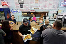 Patrons order food at Rudy's Seafood Friday March 7, 2014.