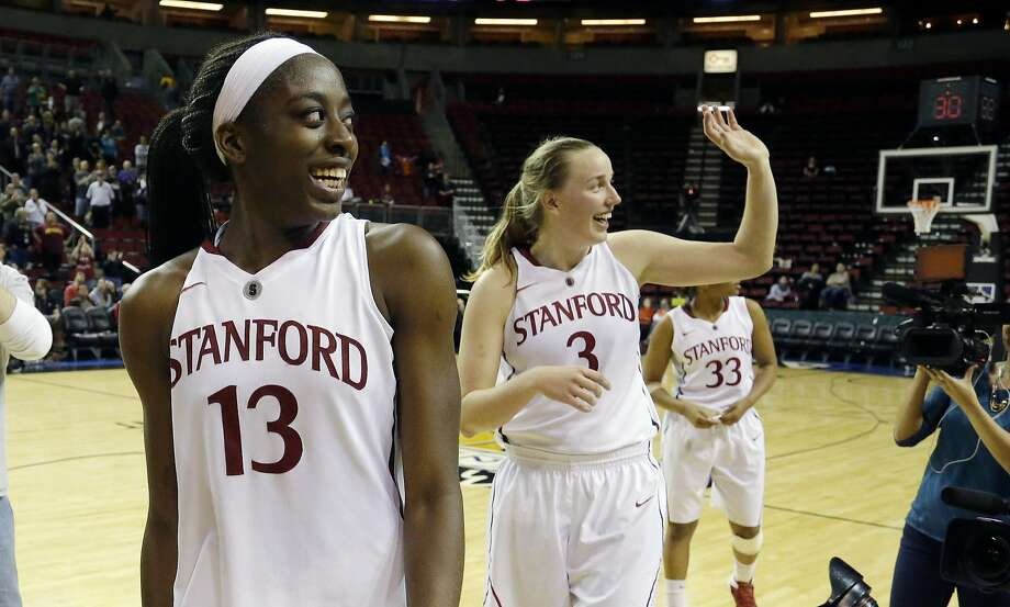 Chiney Ogwumike (left) and Mikaela Ruef leave the court on the winning end of a Pac-12 quarterfinal in Seattle. Photo: Ted S. Warren, Associated Press