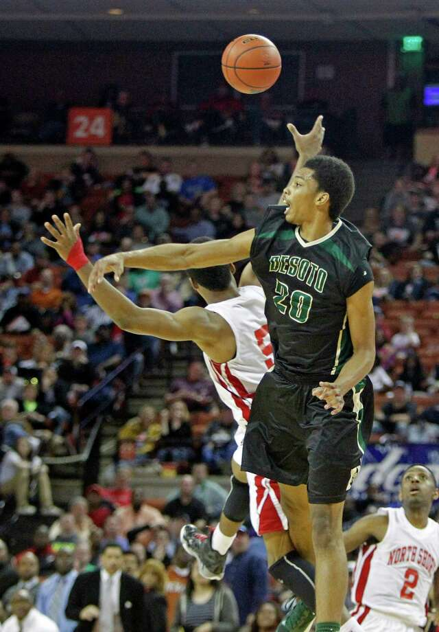 DeSoto guard Devin Wyatt (20) knocks the ball away from Galena Park North Shore guard Brandon Green during a boys' UIL Class 5A state basketball semifinal, Friday, March 7, 2014, in Austin, Texas. (AP Photo/Michael Thomas) Photo: Michael Thomas, Associated Press / FR65778 AP