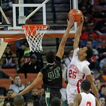 Galena Park North Shore guard Jarrey Foster (25) goes up for a dunk that was blocked by DeSoto forward Devin Wyatt (20) during a boys' UIL Class 5A state basketball semifinal, Friday, March 7, 2014, in Austin, Texas. (AP Photo/Michael Thomas) Photo: Michael Thomas, Associated Press / FR65778 AP
