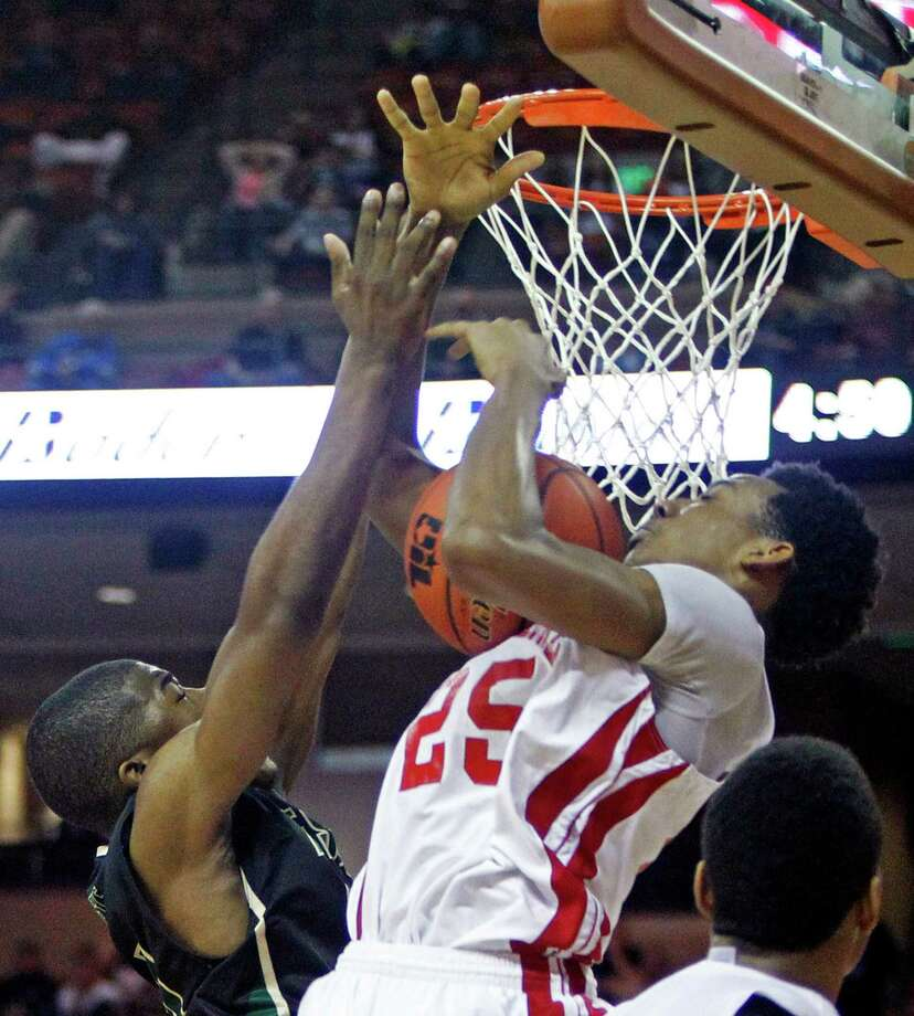 Galena Park North Shore guard Jarrey Foster (25) comes down with a rebound against DeSoto guard Cedric Carson during a boys' UIL Class 5A state basketball semifinal on Friday, March 7, 2014, in Austin, Texas. (AP Photo/Michael Thomas) Photo: Michael Thomas, Associated Press / FR65778 AP